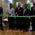 Veridian Cuts Ribbon on Branch